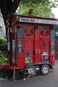 not sure what this is all about. appears to be a paddy wagon and a coffee cart? it's in edinburgh.