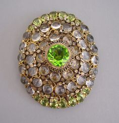 HOBE chartreuse unfoiled rhinestones and clear quartz cabochons large oval dress clip set in gold tone filigree