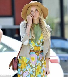 Actress Isabel Lucas in a 70s vintage dress with 70s vintage satchel bag