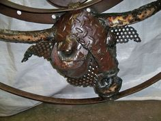 Bull on the wall Horse sculpture made from recycled scrap metal pieces by Mark Olmstead of Post Falls Idaho