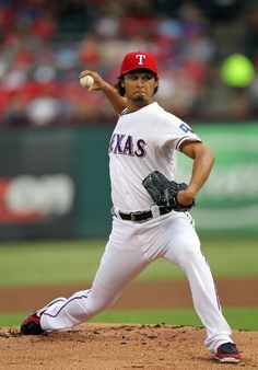 ARLINGTON, TX - JULY 27: Yu Darvish #11 of the Texas Rangers pitches against the Chicago White Sox on July 27, 2012 at the Rangers Ballpark in Arlington in Arlington, Texas. (Photo by Layne Murdoch/Getty Images)  game 98