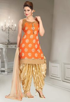 Readymade Art Silk Jacquard Punjabi Suit in Orange This Sweet Heart Neck attire with Faux Crepe Lining is Prettified with Brooch, Foil Print, Stone, Zari and Patch Border Work Available with a Lycra Patiala, Net Dupatta in Beige and an Attachable Half Sleeve The Kameez and Bottom Lengths are 34 and 40 inches respectively Do note: The Length may vary upto 2 inches. Accessories shown in the image are for presentation purposes only.(Slight variation in actual color vs. image is possible).