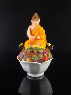 Om:  needle felted Buddha (by Kathleen Dodge-DeHaven).