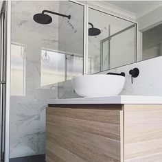 Matte Black tap, faucet and shower head. Timber vanity with white stand alone basin. Project by - @lotnine08interiors #interiordesign #taps #bathroom #bathroomdesign #bathroomcollective Visit our website for more www.bathroomcollective.com.au