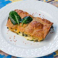 This spinach pie is as simple as it gets. Which means that you don't have to be an experienced chef to make it and you won't run into many problems while cooking it. Its delicious flavor comes from the generous amount of cheese we poured into it. It's also spiced up with nutmeg, paprika, and some Dijon mustard.