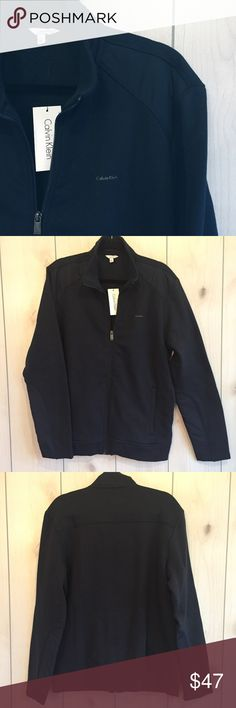 Men's Sweatshirt Perfect casual Calvin Klein sweatshirt. Navy blue cotton with a waterproof material on shoulders and bottom of sleeves. Fleece lined, perfect for the colder weather. Brand new with tags. Calvin Klein Shirts Sweatshirts & Hoodies