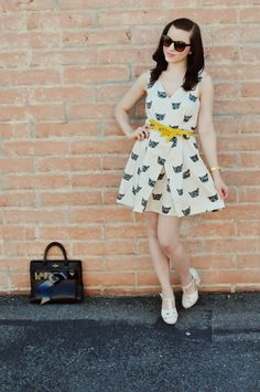 love the black & cream printed dress with this awesome bright yellow, uniquely shaped belt ~ Emily of Yesterday's Sweetheart