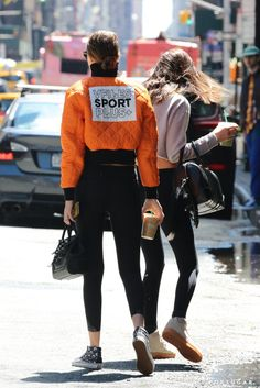 Pin for Later: These Snaps of Gigi and Bella Hadid Hailing a Cab Will Go Down in Fashion History  Gigi turned around and showed off her quilted VFiles bomber.