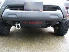 toyota tacoma custom skid plate and tow hook. Perfect for off roading! Tacoma Pro, 2014 Toyota Tacoma, Tacoma Truck, 2016 Tacoma, Toyota Tacoma Accessories, Toyota Hilux, Toyota 4x4, Toyota Trucks, Car Trailer