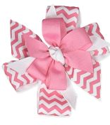 I love the boutique style bows from lollywollydoodle.com...they are really big and they come with a smaller clip to hold even fine baby soft hair!