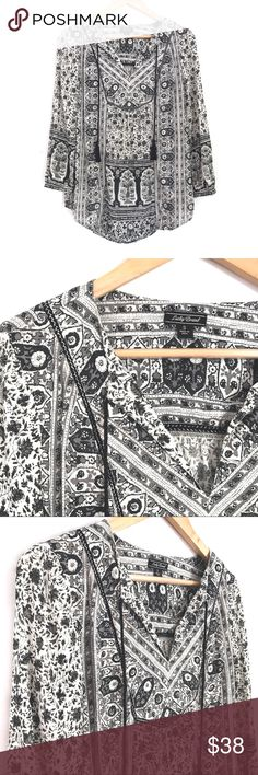 """Lucky Brand Peasant Mixed Print Long Sleeve Top Mixed floral print peasant top by Lucky Brand. Color is shades of gray w/ white. Silver thread is woven into the black accent around bust area. Black tassels hang off the v-neckline adding to the blouse's laid back vibe. Like new, perfect condition. Made in India. 100% viscose. 👌🏼 quality. Long sleeves are gathered at the top & end w/ a button on each, as well as gathering at the bust & on the back. Size Small. B: 42"""", L: 28"""", sleeve L…"""
