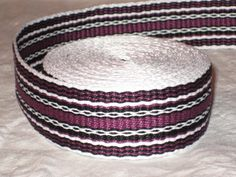 White, grape-purple, and black hand-woven inkle trim (over 14 feet). $40.00, via Etsy.