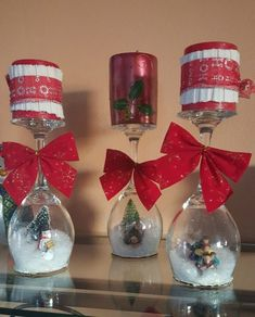 Here is a new twist on the traditional holiday snow globe using wineglasses — can you believe it? When you group several of them together, the result is magical! You can find inexpensive wine… Christmas Glasses, Christmas Candles, Christmas Centerpieces, Christmas Bulbs, Christmas Crafts, Christmas Decorations, Holiday Decor, Wine Glass Crafts, Bottle Crafts