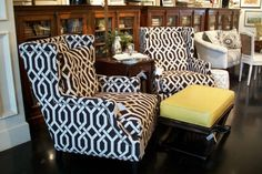 Wing-back club chairs in black and white.