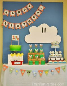 A Super Mario Birthday Party with lots of party DIYs and all the free printables from banners, toppers, decorations, favor boxes and more!