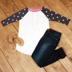 Star Gazing Top is spirited style! This baseball style tee has a solid ivory bodice with navy and ivory stars on the 3/4 raglan sleeves.