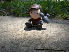 Chibi (little kid) Malcolm Reynolds is playing with his favorite Firefly ship. He is hand sculpted and hand painted. He is light weight and roughly 3