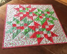 A personal favorite from my Etsy shop https://www.etsy.com/listing/481956487/festive-christmas-star-block-table Quilted table topper