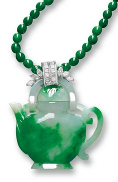 Jadeite 'Teapot' and Diamond Pendant Necklace The translucent jadeite of celadon tone suffused with emerald green colour, carved as a teapot, to a surmount set with brilliant-cut and marquise-shaped diamonds together weighing approximately 2.00 carats, completed by a jadeite bead necklace of intense emerald green colour, mounted in 18 karat white gold, length approximately 620mm. 'Teapot' approximately 34.17 x 48.02 x 12.67mm; jadeite beads approximately 4.69mm.