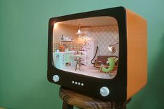 dollhouse- looking at this i thought about a floor model tv in the garage- what a great repurpose try!!!