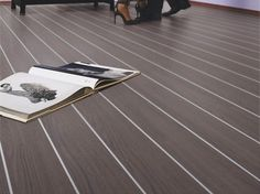 Create a cool, contemporary look with this Bliss Art Galiano Oak flooring! The boards are separated by aluminium strips! Grey Floorboards, Oak Laminate Flooring, Dark Grey, Contemporary, Cool Stuff, Floors, Bliss, Stairs, Eye