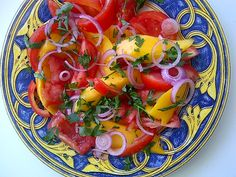 Tomatoes and Mango salad with red onions and balsamic vinegar
