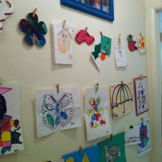 KidArt Wall complete! Used fishing line, push pins and their little creative gems on a small hallway wall.