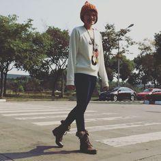 Orange beanies X White Disney Mickey sweats X DL1961 skinny jeans X Steve Madden boots