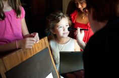 Flower Girl getting her makeup done.