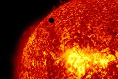 This image provided by NASA shows the Solar Dynamic Observatory's ultra-high-definition view of Venus, black dot at top center, passing in front of the sun on Tuesday, June 5, 2012. The next transit of Venus won't be for another 105 years.
