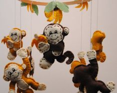 This mobile is bright and fun,  The 5 Australian animals, 4 Gumnuts and the sun have all been hand cut and stitched and made from eco friendly felt. The animals on this mobile are: Kangaroo, Kookaburra, Wombat, Emu and a Platypus. Hanging from the centre is a bright sun and the Kangaroo.  The animals, sun and gumnuts are all made from eco friendly felt and are attached with cotton twine and.  This australiana mobile is made-to-order.  SIZE: *~*~* Kangaroo measures approx 15cm (6). Koala…