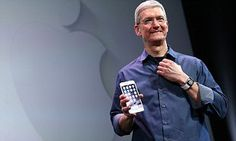 The Californian firm warned investors in January that a decline was imminent, and the official earnings report is expected later today. Apple boss Tim Cook is pictured with the iPhone 6.
