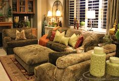 warm beige tones. Plantation shutters. Cozy seating area.