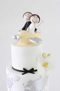 Flying around the world wedding cake with personalised plane topper and silver atlas on bottom tier - Sharon Wee Creations