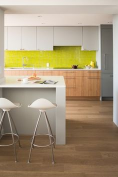 The hit of color brings this kitchen backsplash to life. Glasstints: Cat's Eye Green in custom tile pattern. Photo: Lucas Finlay