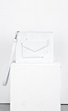 White envelope clutch bag; chic minimal accessories // Low Classic