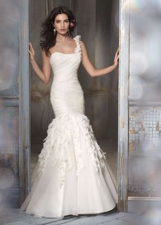 ivory silk organza trumpet bridal gown, one shoulder draped elongated bodice, chiffon, lace and crystal cascade skirt, chapel train