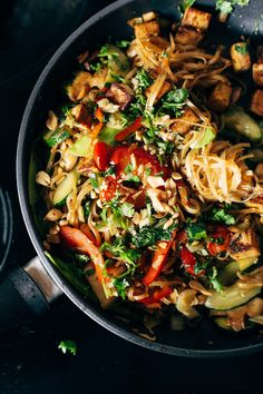 Back Pocket Stir Fry with Noodles - simplicity wins. brown rice noodles with tofu and all kinds of colorful veggies for a quick and easy dinner! vegan, vegetarian. #vegetarian #vegan #cleaneating #healthy #dinnerrecipe #yum | pinchofyum.com