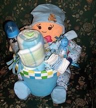 Baby terra cotta pot - that is so cute :-) and a nice change from the diaper cakes.