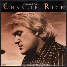 """""""I Still Believe in Love"""", by Charlie Rich, charted in the top 40 on Billboard's Top Country Albums and featured two singles which also charted. """"Puttin' in Overtime at Home"""" reached #8 on U.S. Country Charts and #3 on Canadian Charts and """"I Still Believe in Love"""" charted at #29 on Country Charts in the U.S. In early 1978 Rich left Epic Records to join United Artists Records to record this album. The Jordanaires provided backup to Charlie Rich. (Vinyl LP)"""