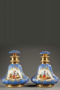 Pair of Charles X porcelain bottles signed Darte