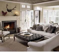 Love the furniture in this room (not the antlers!)