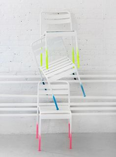 Perk up plain old patio chairs in five minutes flat with a little neon (or any other color) paint. #DIY