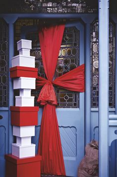 this classic front door has been pimped up for christmas with an extra wide and extra long piece of red ribbon it makes a really fun and modern - Modern Christmas Front Door Decorations