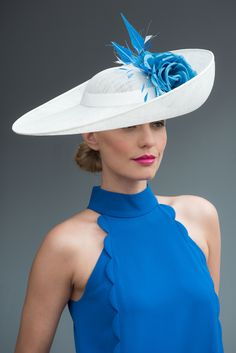 Handcrafted in our London studio.Sinamay upturned hat with Silk flowers, coque feathers and arrowhead quills.Secured with a hairband.Colour: Ivory/Blue.1 in stock, delivery 3-5 business days. Sent free within the UK. Includes a Black #HatsForWomenRaces