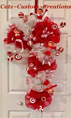 A silver Christmas decoration - HomeCNB Candy Cane Decorations, Silver Christmas Decorations, Christmas Mesh Wreaths, Deco Mesh Wreaths, Christmas Diy, Christmas Ornaments, Angel Ornaments, Candy Cane Christmas, Deco Mesh Crafts