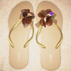 J.Crew Flip Flops Size 9. Golden / beige. Front detail. Super cute. (Bottoms have spot where price was marked off), otherwise they are perfect condition. J. Crew Shoes Sandals