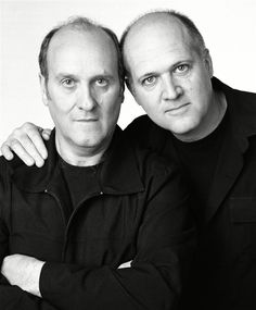 """I'm Not a Look-Alike! - The pairs in these images are not twins - or even related. Instead, they're strangers that Canadian photographer Francois Brunelle photographed together: a project called """"I'm Not a Look-Alike!"""" He spent 12 years tracking down people with eerily similar features. Pictured here: Normand Lévesque, Claude Mauffette"""