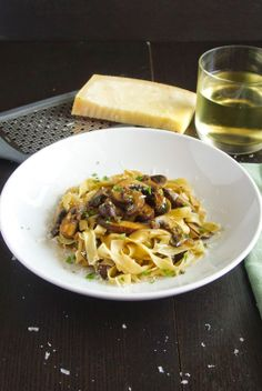 Fresh homemade pasta topped with mushrooms cooked in wine.