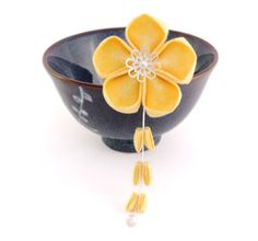 Kaname- Pretty round petal kanzashi made from yellow cotton with a subtle floral pattern.